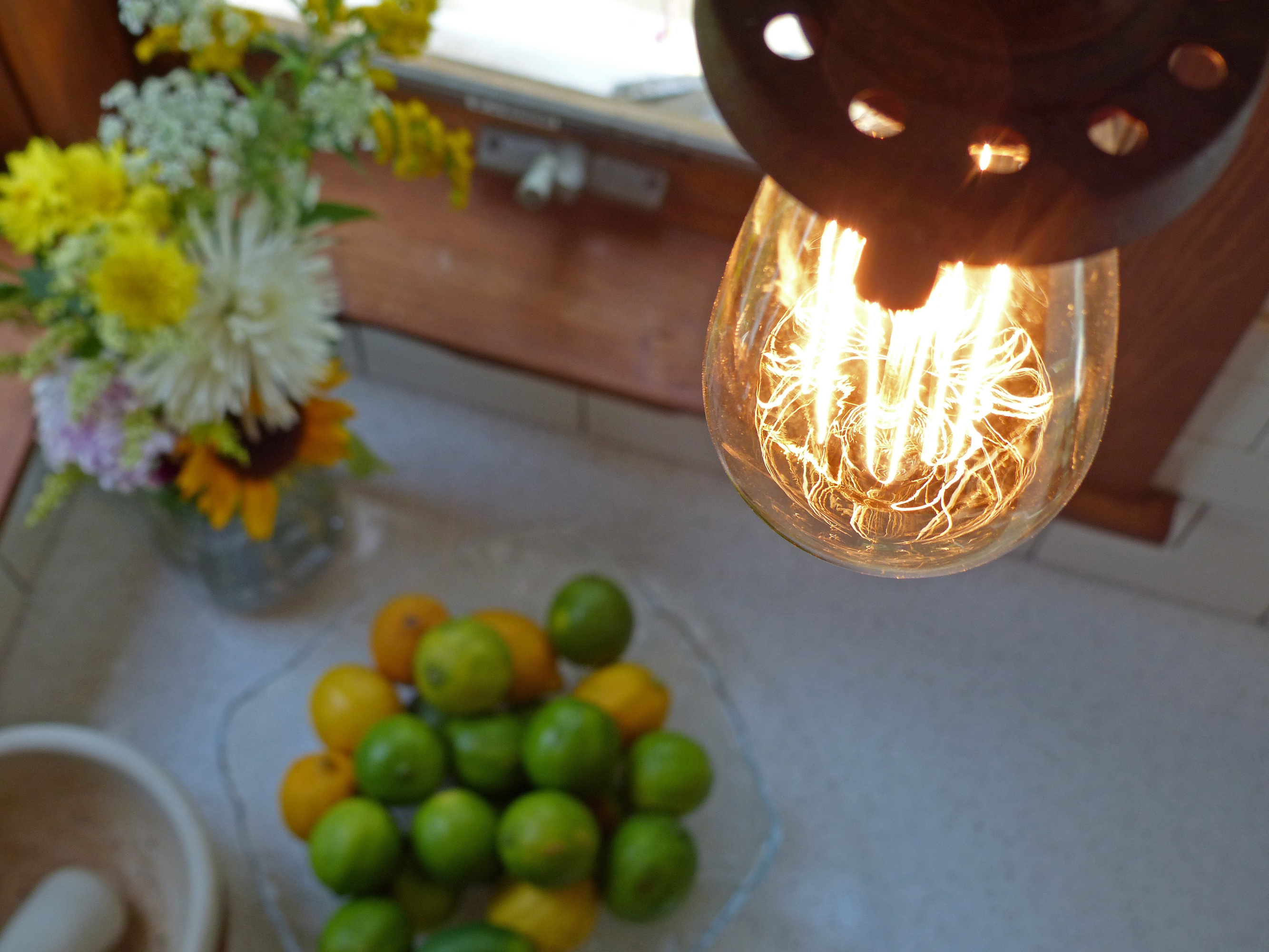 industrial rustic light bulb shining in a farmhouse diy project